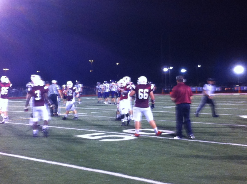 Eudora players celebrate with 44 seconds remaining  in the game after stopping Louisburg's final fourth down attempt.